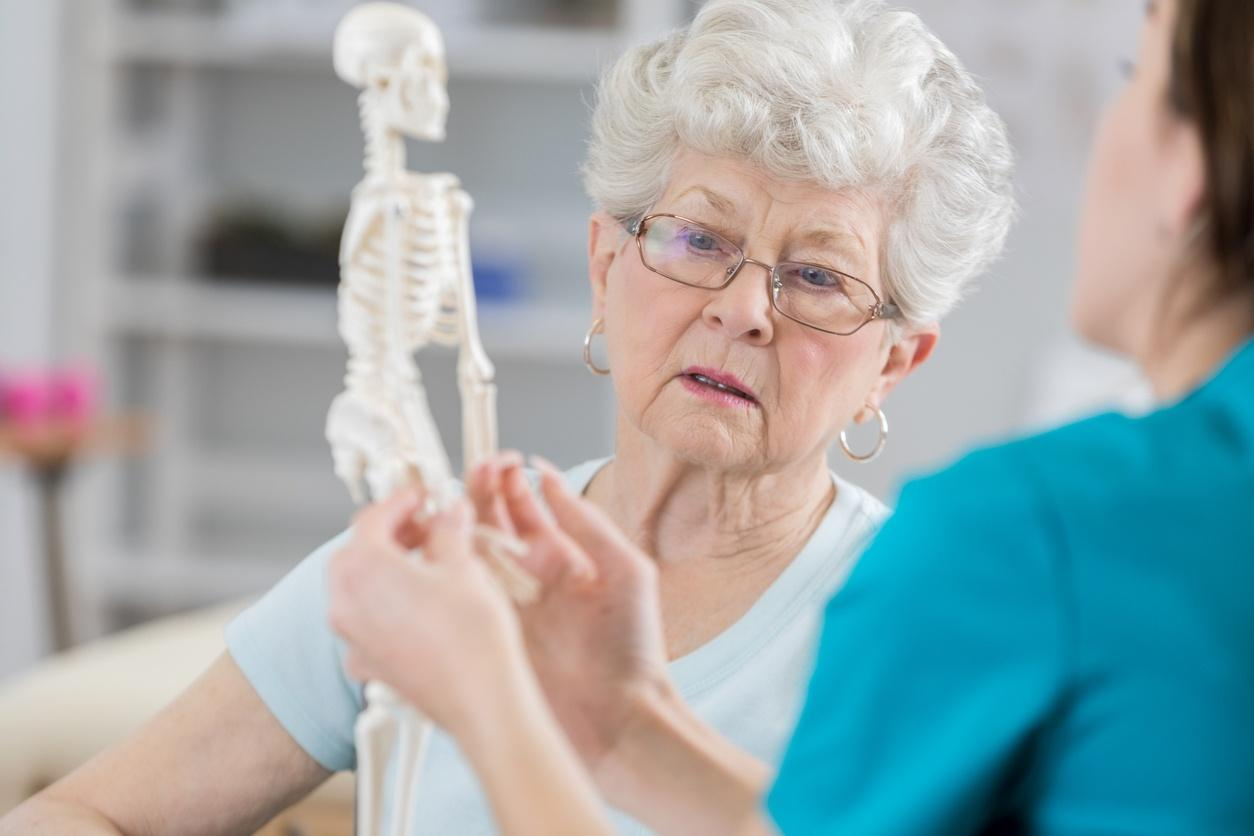 Senior woman discusses posture with physical therapist
